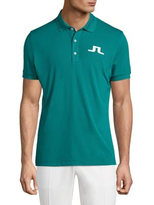 Image of Classic streamlined polo with logo embroidery. Polo collar. Short sleeves. Banded cuffs and hem. Three-button plackets. Polyester. Machine wash. Imported.