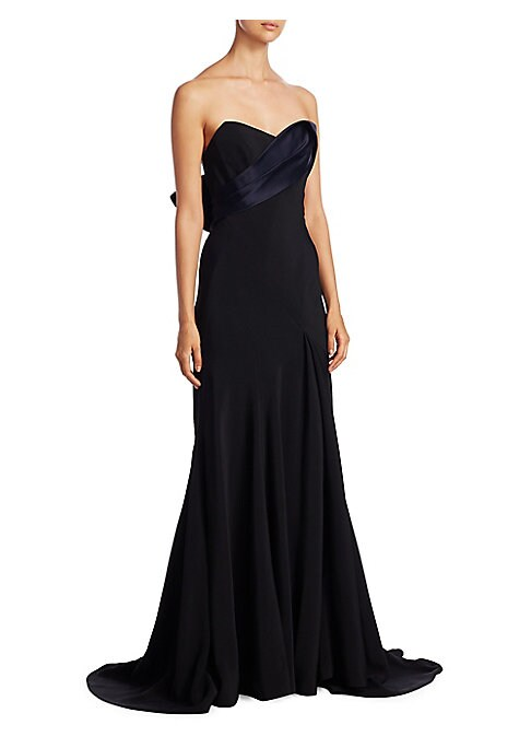 """Image of Strapless gown with dramatic back bow detail. Strapless. Sweetheart neckline. Concealed back zip closure. About 60"""" from shoulder to hem. Acetate/viscose. Dry clean. Made in USA. Model shown is 5'10"""" (177cm) wearing US size 4."""