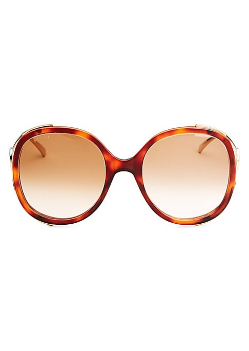 Image of From the Urban Collection. Opulent oversized oval frames with goldtone hues.56mm lens width; 22mm bridge width; 130mm temple length.100% UV protection. Gradient lenses. Metal. Made in Italy.