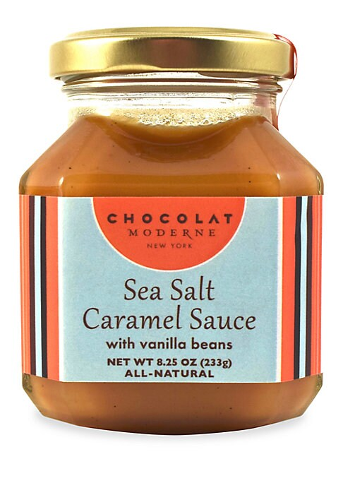 Image of From the Caramel Sauces Collection. This Sea Salt Caramel Sauce is dotted with Madagascar Bourbon vanilla. It is fantastic on ice cream and can be a surprise partner for cheese. Serves 1-7.8.25 oz. Shelf life: 1 year. Made in USA.