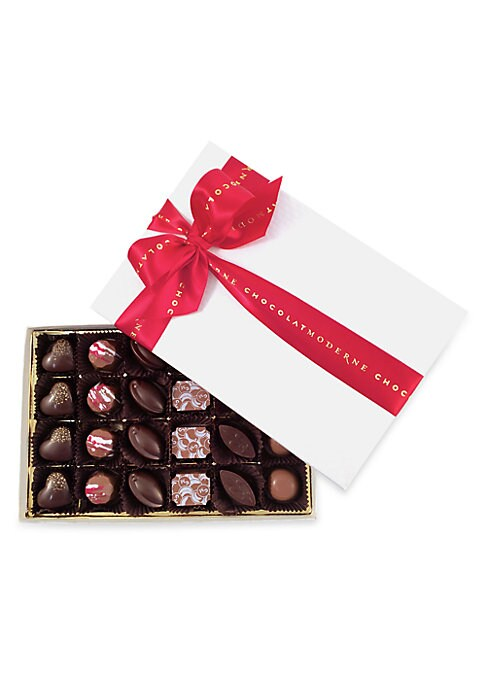 Image of From the SAKS Collections. Varied assortment of milk and dark chocolates with ganache, caramel, praline and marzipan fillings. Includes: 24 pieces.11 oz. Shelf life: 3 months kept at or below 68-degree Fahrenheit and 55% relative humidity. Made in USA.