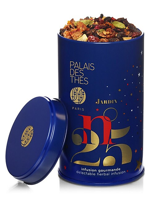Image of Palais des Thes Holiday Herbal blend is a caffeine-free herbal infusion with notes of citrus, rose, almonds and spices. This loose tea in a round tin, with its fruity and spicy notes, is the perfect beverage to sip on long evenings during the holidays. Ma