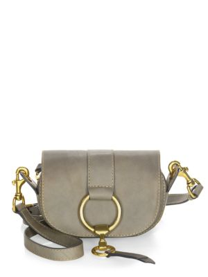 """Image of .On-trend mini bag tailored from fine leather. .Removable shoulder straps, 22.5"""" drop. .Magnetic flap and top zip closure. .Leather trim. .Antique brass hardware. .One exterior slip pocket. .Lined. .Includes dust bag and authenticity card. .7""""W x 5""""H x 2."""