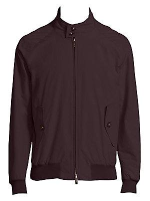 "Image of Sleek monochromatic jacket with slim profile Stand collar Long raglan sleeves Rib-knit cuffs and hem Front zip Waist button flap pockets About 33"" from shoulder to hem Cotton/polyester Machine wash Imported. Men Adv Contemp - Contemporary Outerwear. Barac"