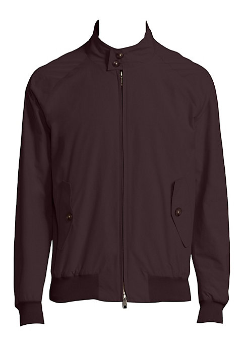 "Image of Sleek monochromatic jacket with slim profile. Stand collar. Long raglan sleeves. Rib-knit cuffs and hem. Front zip. Waist button flap pockets. About 33"" from shoulder to hem. Cotton/polyester. Machine wash. Imported."
