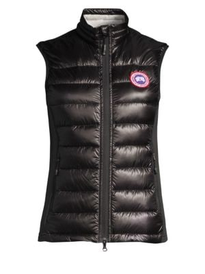 "Image of A down-filled yet lightweight packable vest featuring signature Canada Goose design details. Stand collar. Sleeveless. Two-way zip front. Zippered slash pockets. Packable into interior pocket. About 26"" from shoulder to hem. Lined. Nylon. Lining: polyeste"