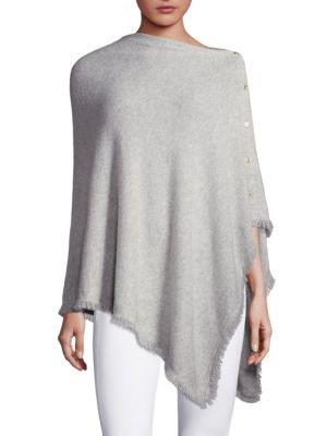 """Image of Cashmere wrap with tiny fringe trim details. Asymmetrical neckline. Side button closure. About 56"""" from shoulder to hem. Cashmere. Dry clean. Imported."""