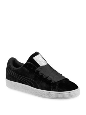 Image of Padded low top sneakers accented with thick laces. Velour upper. Round toe. Lace-up vamp. Padded tongue and collar. Rubber sole. Imported.