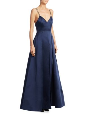 """Image of Elegant satin ball gown with exposed strappy back.V-neck. Spaghetti straps. Empire waist. Front slit. Exposed back zip. Lined. About 56"""" from shoulder to hem. Polyester/silk/elastane. Dry clean. Imported. Model shown is 5'10"""" (177cm) wearing US size 4."""