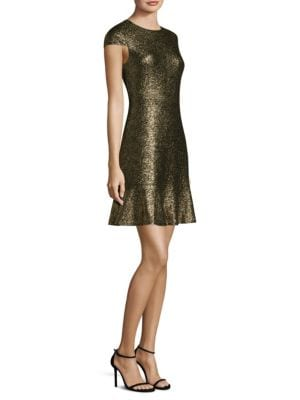 """Image of A-line dress finished with sparkling metallic glitter. Crewneck. Cap sleeves. Concealed back zip. Peplum hem. About 36"""" from shoulder to hem. Polyester/elastane. Hand wash. Imported. Model shown is 5'10"""" (177cm) wearing size Small."""