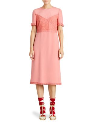 "Image of .Romantic dress with delicate lace details. Roundneck. Short sleeves. Lace cuffs and hem. Concealed back zip. About 51"" from shoulder to hem."