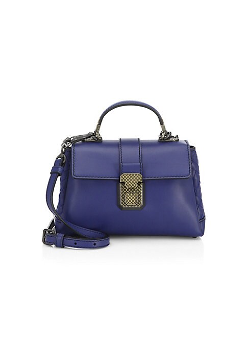 Image of A must-have top handle bag with multiple carry options. Top carry handle. Removable, adjustable shoulder strap. Two main compartments. Genuine leather. Made in Italy.