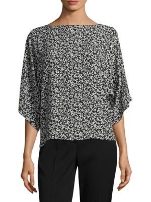 "Image of Floral printed top crafted in lavish silk. Bateau neckline. Three-quarter sleeves. Pullover style. About 25"" from shoulder to hem. Silk. Dry clean. Made in Italy. Model shown is 5'10"" (177cm) and wearing US size Small."