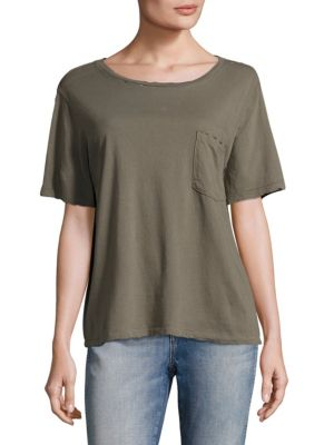 """Image of Patch pocket tee crafted in lightweight cotton. Roundneck. Short sleeves. Front patch pocket. Pullover style. About 23"""" from shoulder to hem. Cotton. Dry clean. Made in USA. Model shown is 5'10"""" (177cm) and wearing US size Small."""