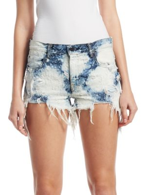 """Image of Bleached tie dye shorts with distressed detailing. Belt loops. Front zip-fly with button closure. Five-pocket style. Rise, about 3"""".Inseam, about 9"""".Cotton. Dry clean. Imported. Model shown is 5'10"""" (177cm) wearing a size 4."""
