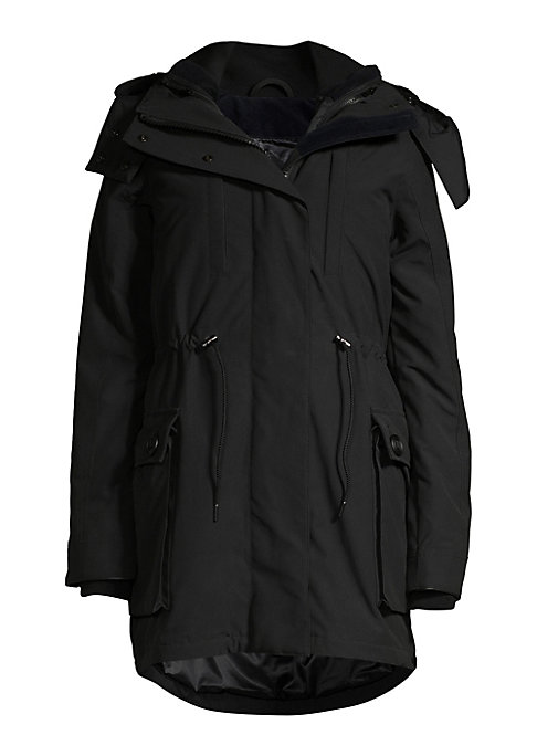 Image of Insulating utility parka with shearling trim hood and removable quilted vest. Removable adjustable hood with shearling trim. Long sleeves with rib-knit cuffs. Drawstring waist. Concealed front zip closure with snap buttons. Chest welt pockets with zip clo