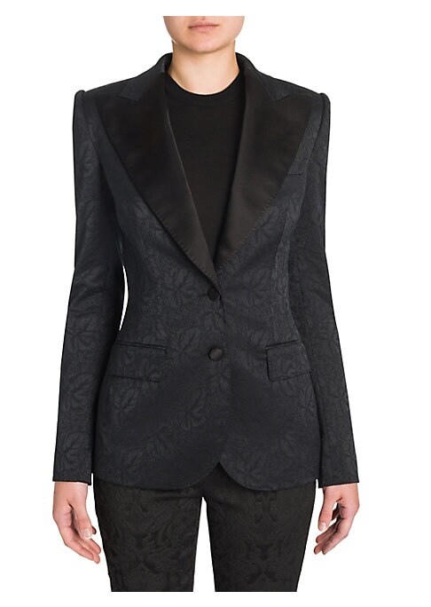 """Image of Alluring jacquard jacket in subtle floral pattern. Notch satin lapels. Long sleeves. Button front. Front flap pockets. Lined. About 27"""" from shoulder to hem. Polyester/acetate/rayon/silk/spandex. Lining: Spandex/silk. Dry clean. Made in Italy. Model shown"""