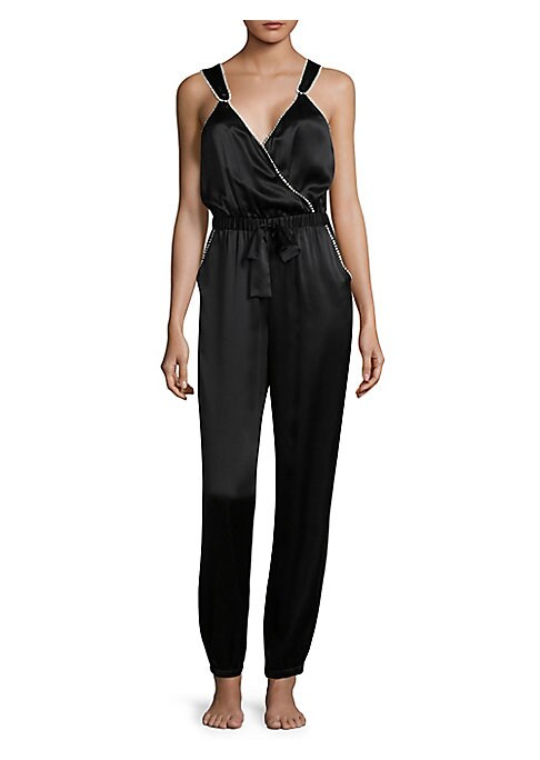 "Image of Silk charmeuse jumpsuit with fitted waist and metallic pom pom trim. Surplice neckline. Sleeveless. Elasticized waist. Self-tie at front. Side seam pockets. Rise, about 11"".Inseam, about 30"".Leg opening, about 3"".About 58"" from shoulder to hem. Silk. Hand"
