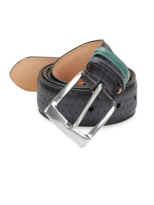 Image of Leather belt finished with a perforated design. Leather. Imported.
