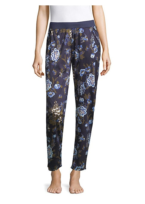 """Image of Comfortable sleepwear pants with oversized floral print. Elasticized waist. Side angled pockets. Pull-on style. Tapered-leg. Inseam, about 28"""".Modal. Hand wash. Imported."""