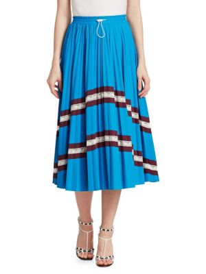 """Image of On-trend colorblock graphics update pleated skirt. Banded drawstring waist. Pull-on style. Box pleats. About 32"""" long. Nylon/spandex/cotton/nylon. Dry clean. Made in Italy. Model shown is 5'10"""" (177cm) wearing US size Small."""