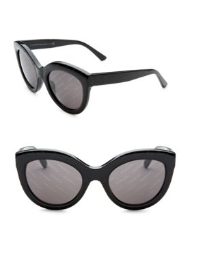 Image of Cat eye sunglasses with polished finish.54mm lens width; 22mm bridge width; 140mm temple length.100% UV protection. Acetate. Imported.
