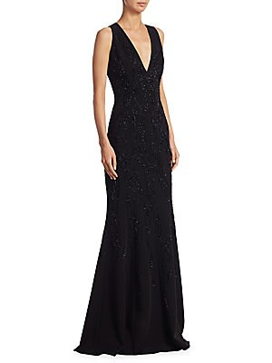 "Image of Beaded sleeveless silk gown in sultry style Deep V-neck Sleeveless Concealed back zip About 64"" from shoulder to hem Silk Dry clean Imported Model shown is 5'10"" (177cm) wearing US size 4. Designer Evenin - Classic Evening > Saks Fifth Avenue. Carmen Marc"