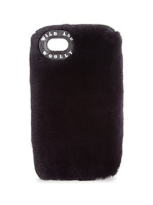 "Image of Chic fluffy case in dyed mink fur Fits iPhone 7 3.5"" W x 6.5"" H Fur type: Dyed mink fur Fur origin: Finland Made in USA. Handbags - European Collection Hdba. Wild and Woolly. Color: Midnight Blue."