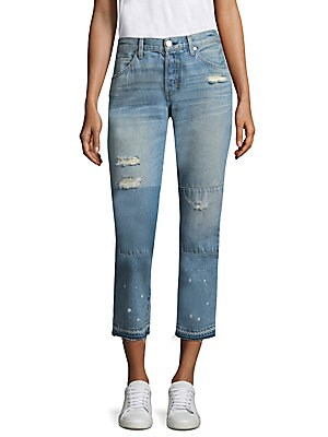 Image of Cropped boyfriend jeans with distressed details and faded design Belt loops Zip fly with button closure Five-pocket style Distressed details and patches Raw hem Rise, about 10 Inseam, about 26 Leg opening, about 13 Cotton Machine wash Made in USA Model sh