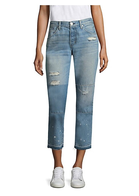 """Image of Cropped boyfriend jeans with distressed details and faded design. Belt loops. Zip fly with button closure. Five-pocket style. Distressed details and patches. Raw hem. Rise, about 10"""".Inseam, about 26"""".Leg opening, about 13"""".Cotton. Machine wash. Made in U"""