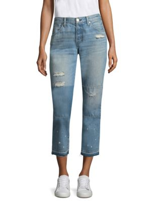 """Image of Distressed boyfriend jeans. Five-pocket style. Button fly. Distressed details and patches. Raw hem. Rise, about 9.5"""".Leg opening, about 13"""".Inseam, about 26"""".Cotton. Machine wash. Made in USA. Model shown is 5'10"""" (177cm) wearing US size 4."""