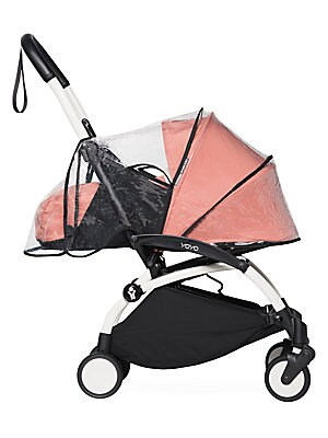 Image of From the YOYO+ Collection. Designed to go anywhere, this durable rain cover folds easily and boasts easy Velcro attachments for your BabyZen stroller. Compatible with BabyZen 0+ stroller Foldable Comes with travel pouch Velcro attachments Polyurethane Han