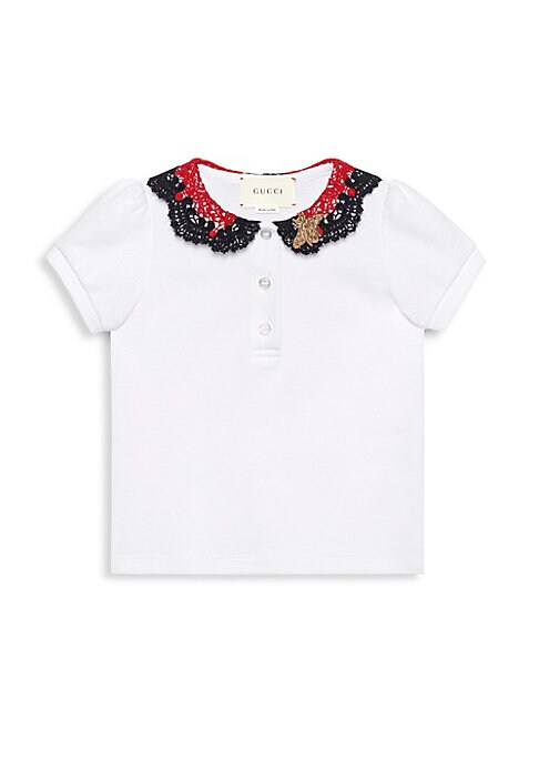 Image of Delicate embroidery adorns cute polo. Embroidered polo collar. Short sleeves. Three-button placket. Cotton. Machine wash. Made in Italy of imported fabric.