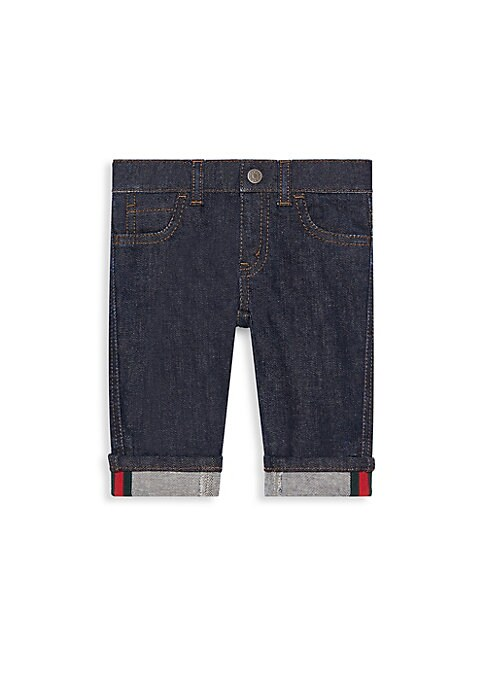 Image of Edgy jeans with iconic Gucci Web adornments. Zip fly with button closure. Mock five-pocket style. Cuffed hem with green and red Web. Cotton/spandex. Machine wash. Made in Italy of imported fabric.