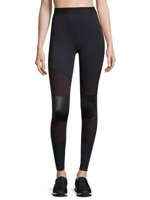 "Image of Ahletic tights with exposed seams and mesh inserts. Banded waist. Rise, about 10"".Inseam, about 26.5"".Polyester/spandex. Machine wash. Made in Canada of imported fabric. Model shown is 5'10"" (177cm) wearing US size Small."