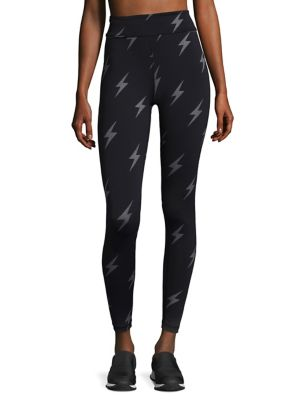 "Image of Athletic tights featuring lightning bolt print. Inner power mesh waistband. Key pocket. Back zip pocket. Anti-chafe seaming. Rise, about 10"".Inseam, about 26.5"".Quick dry fabric. Polyester/spandex. Machine wash. Made in Canada of imported fabric. Model sh"