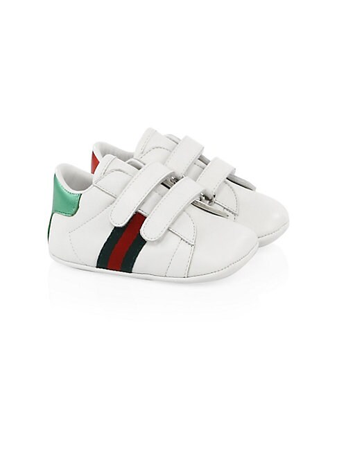 Image of Sporty sneakers with iconic Gucci Web. Leather upper. Round toe. Grip tape closure. Leather lining and sole. Padded insole. Made in Italy.
