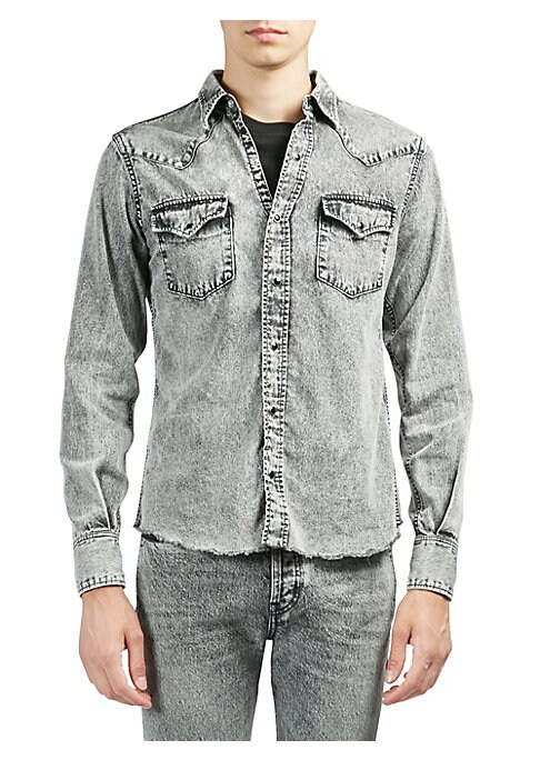 Image of Cotton denim shirt with frayed hemline. Spread collar. Long sleeves. Snap barrel cuffs. Front snap closure. Chest snap flap pockets. Cotton. Dry clean. Imported.