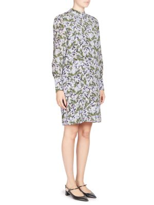 """Image of Floral printed dress crafted in luxurious silk. Mockneck. Long sleeves. Back keyhole. Pullover style. About 37"""" from shoulder to hem. Silk. Dry clean. Imported. Model shown is 5'10"""" (177cm) and wearing US size 4."""