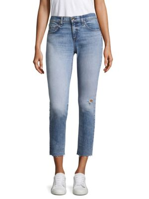 "Image of Medium-wash skinny jeans with distressed details. Five-pocket style. Zip fly with button closure. Raw hem. Rise, about 8.5"".Leg circumference, about 12"".Inseam, about 27"".Cotton/spandex. Machine wash. Made in USA. Model shown is 5'10"" (177cm) wearing US s"