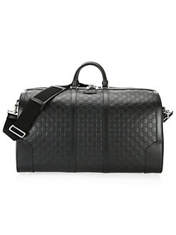 ace421428f38 Logo Embossed Leather Duffle Bag BLACK. QUICK VIEW. Product image
