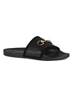 82c3ee68149 Gucci. Pursuit Horsebit Leather Slides
