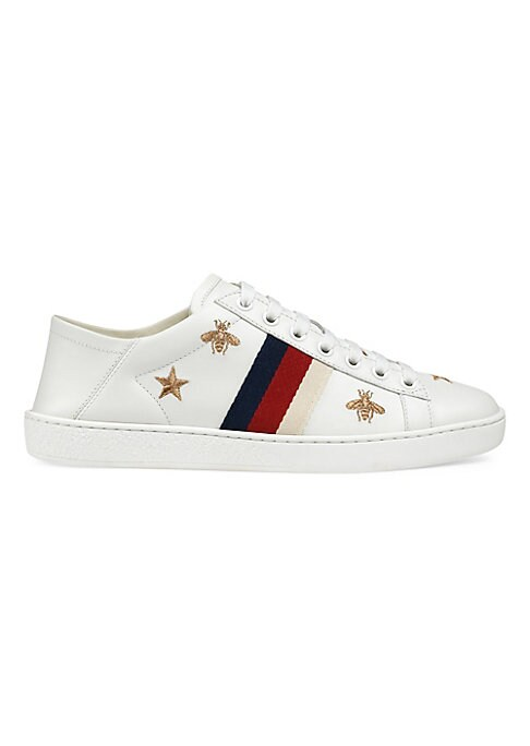 Image of Leather sneakers with embroidered bees and stars. Leather upper. Round toe. Lace-up vamp. Rubber sole. Made in Italy.