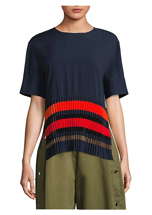 """Image of Striking top with colorful pleat details. Roundneck. Short sleeves. Step hem. Pullover style. About 25"""" from shoulder to hem. Polyester. Dry clean. Imported. Model shown is 5'10"""" (177cm) wearing US size 4."""