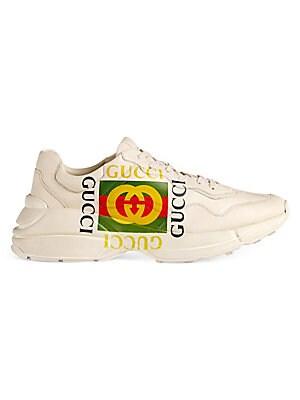 6689bf507f6 Gucci - Rhyton Gucci Logo Leather Sneakers