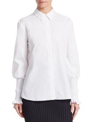 "Image of Crisp poplin shirt, updated with whimsical cuffs. Point collar. Long sleeves. Smocked cuffs with ruffle. Button front. Shirt tail hem. About 26"" from shoulder to hem. Cotton. Dry clean. Made in Italy. Model shown is 5'10"" (177cm) wearing US size 4."