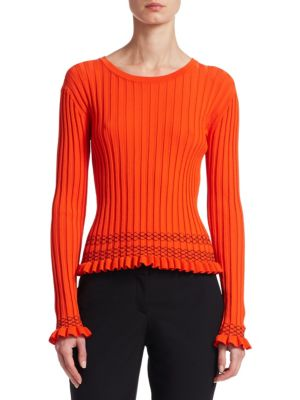 "Image of Contrast smocked waist elevates ribbed sweater. Scoopneck. Long sleeves. Ruffle cuffs. Pullover style. Ruffled hem. Fitted. About 20"" from shoulder to hem. Viscose. Dry clean. Imported. Model shown is 5'10"" (177cm) wearing US size Small."