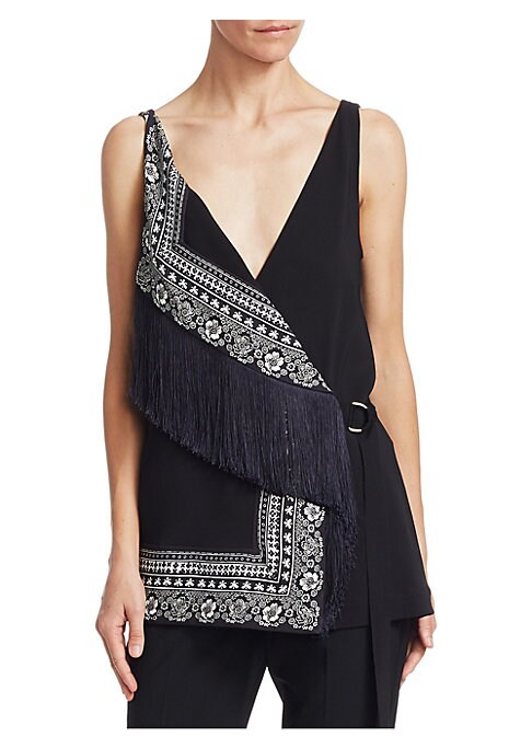 """Image of Fringe and print meet in compelling wrap top. Surplice neckline with attached fringe. Shoulder straps.D-ring belted waist. Wrap silhouette. About 26"""" from shoulder to hem. Viscose/elastane. Dry clean. Made in Italy. Model shown is 5'10"""" (177cm) wearing US"""