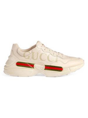 Image of Leather with Gucci vintage logo. Gucci logo tag. Rubber sole. Made in Italy.