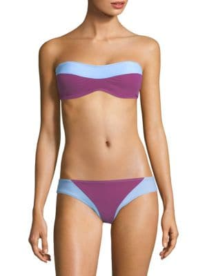 Image of Tonal colorblocking adds shape to bandeau top. Sweetheart neckline. Double back clasp closure. Polyamide/elastane. Hand wash. Made in USA. Please note: Bikini bottom sold separately.